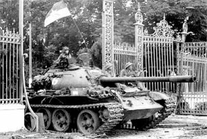 A North Vietnamese tank crashes through the gates of the Presidential Palace of then South Vietnam in Saigon on April 30, 1975. The taking of the palace marked the fall of the U.S.-backed south and the end to a decade of fighting.